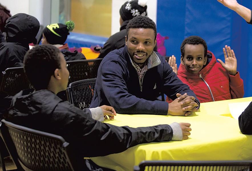 Mohamed Jafar speaking with kids at the King Street Center - LUKE AWTRY