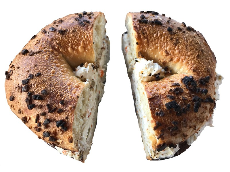Toasted garlic bagel with vegetable cream cheese - COURTESY OF FELDMAN'S BAGELS