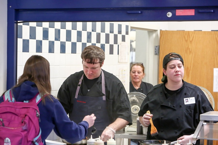 Hen of the Wood chef Jordan Ware serves lunch along with his sister Kate Dupee at Burlington High School - COURTESY OF BURLINGTON HIGH SCHOOL