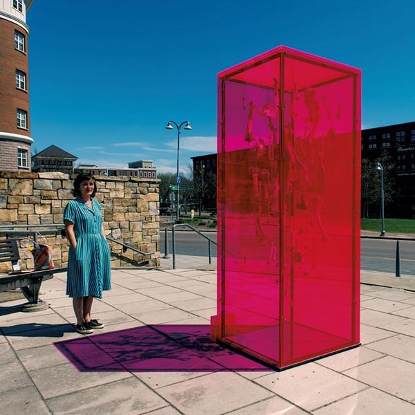 "Lydia Kern with her Waking Windows art installation ""Perpetual Light"" - COURTESY OF DANIEL JAMES CARDON,"