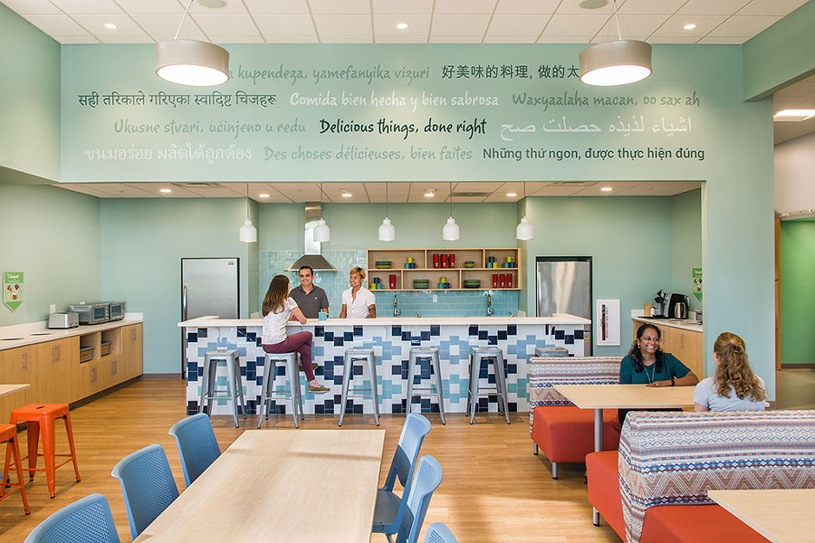 The cafe at Rhino Foods reflects the diversity of the company's workforce. - COURTESY OF CHRISTINE BURDICK DESIGN