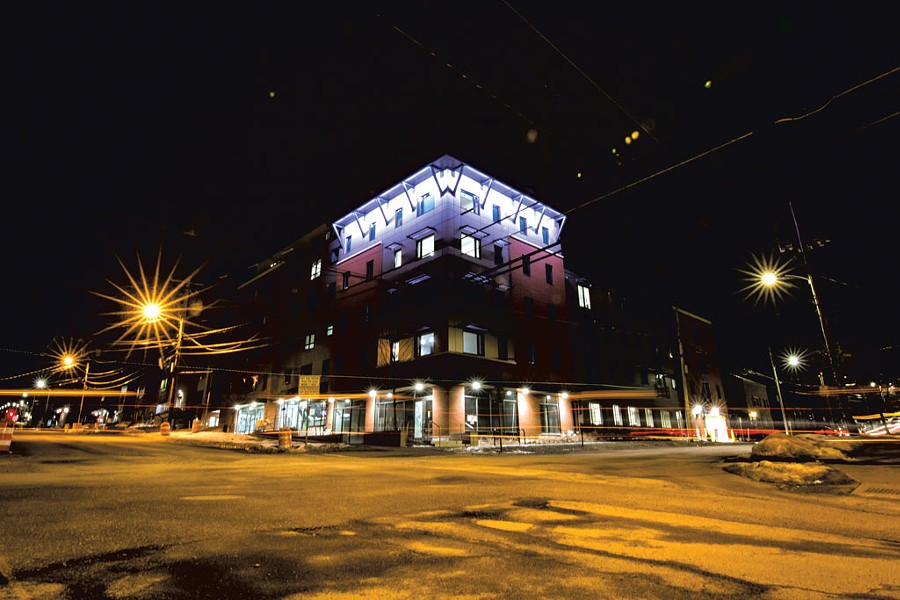 At night, faÇade lighting accentuates architectural details on the building - LUKE AWTRY