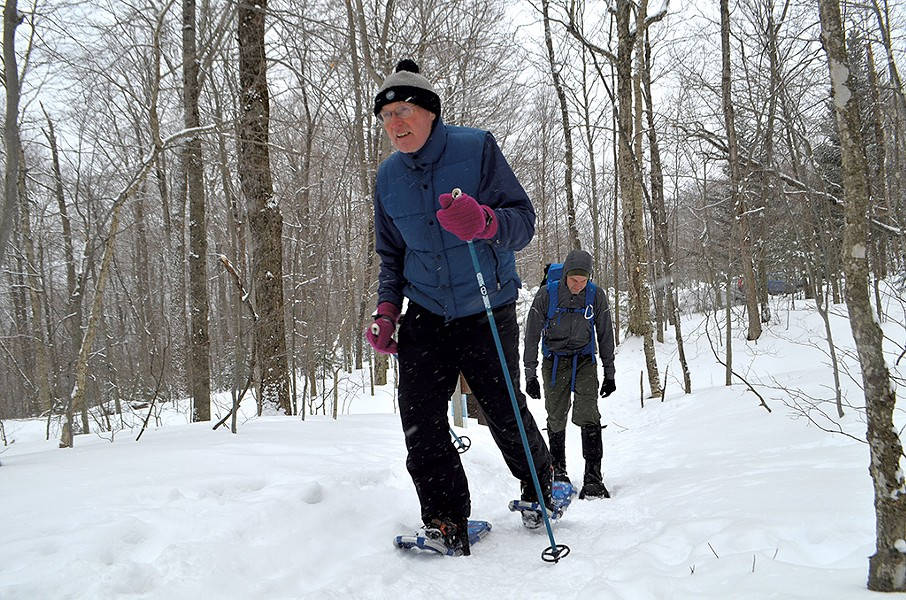 Rep. Curt McCormack and his son, Jamie, snowshoeing up Camel's Hump - KEVIN MCCALLUM