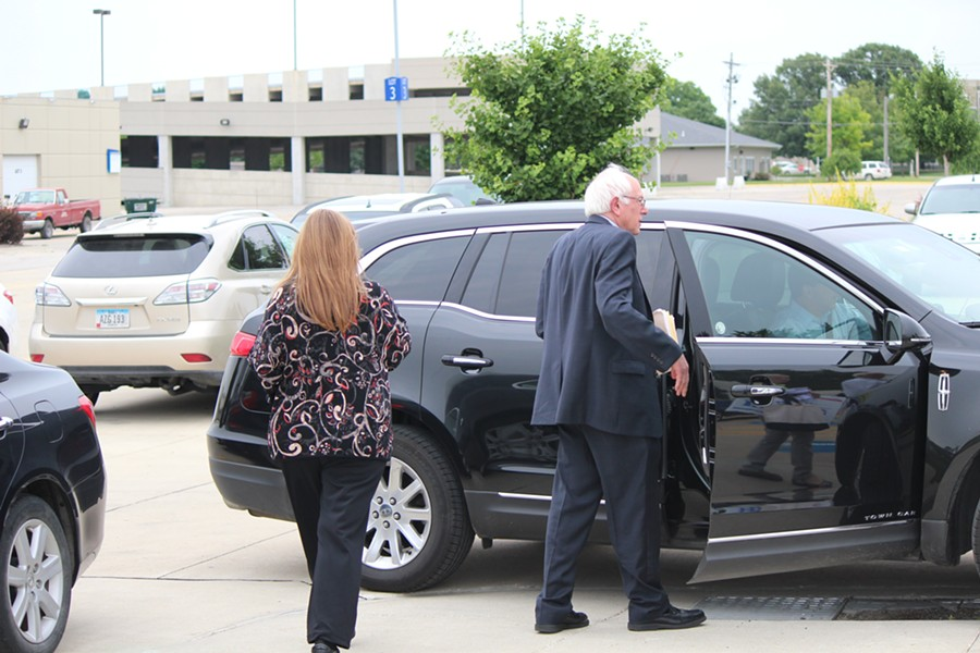 Jane Sanders and Sen. Bernie Sanders walk to their car outside Iowa Central Community College Thursday in Fort Dodge, Iowa. - PAUL HEINTZ