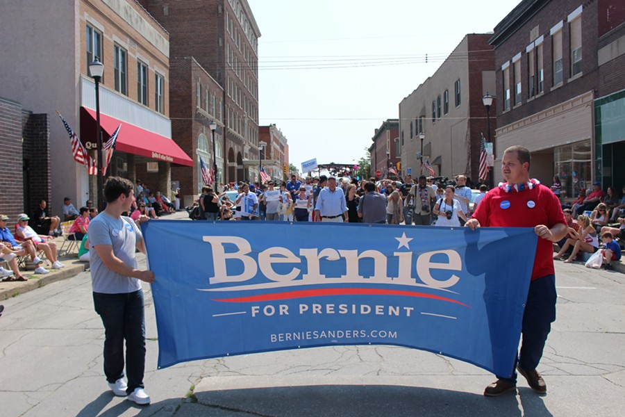 Sen. Bernie Sanders marches in the Creston, Iowa, Independence Day Parade. - PAUL HEINTZ