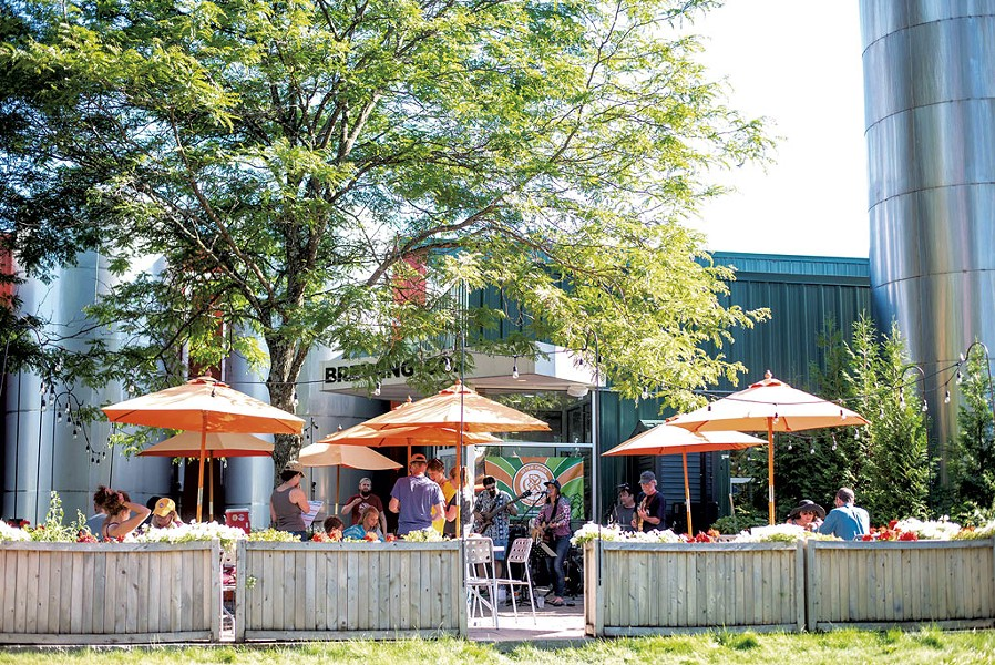 Seasonal patio at Otter Creek Brewing - COURTESY OF OTTER CREEK BREWING