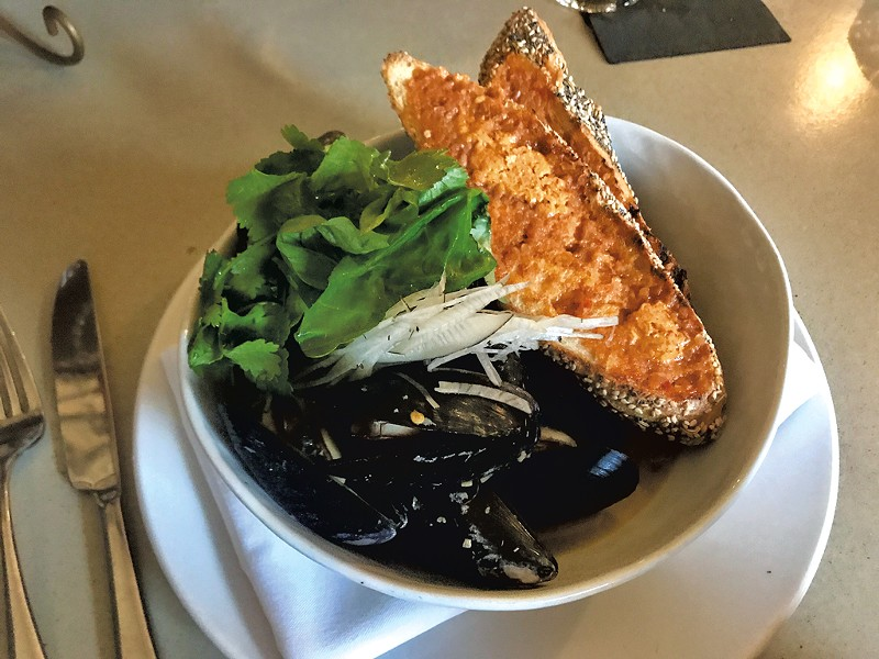 Mussels and grilled bread with kimchi butter at Kismet - CHELSEA EDGAR