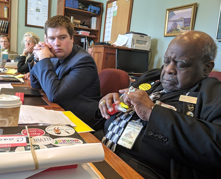 Rep. Kevin Christie (D-Hartford) inspecting a saliva testing device in the House Judiciary Committee - TAYLOR DOBBS