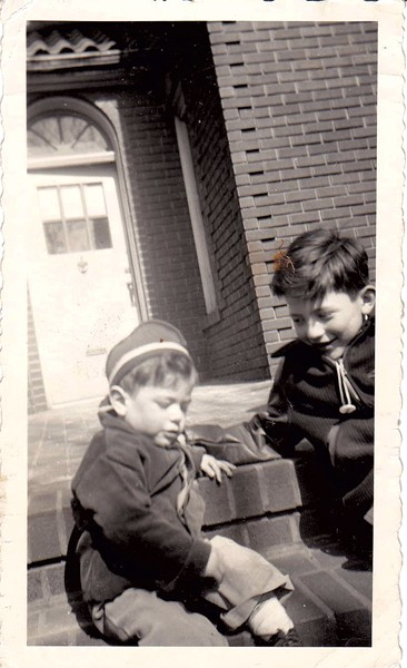 Bernie Sanders (left) and his older brother, Larry, on their street in Brooklyn. They grew up Jewish, but the family was not deeply religious, Larry Sanders said. - COURTESY OF LARRY SANDERS