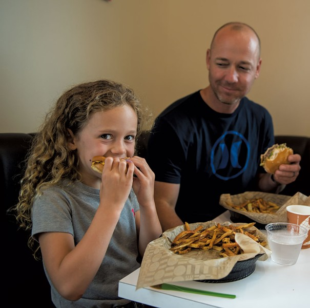 Samantha Pike eating with her dad, Cory Pike, at Bliss Bee - DARIA BISHOP