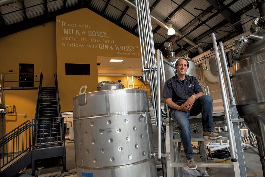 Caledonia Spirits president and head distiller Ryan Christiansen in the distilling room - DARIA BISHOP
