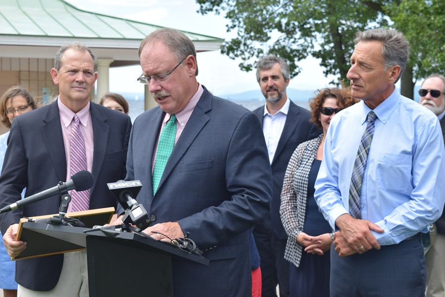 Curt Spalding, Region 1 administrator of the U.S. Environmental Protection Agency, speaks about a new  Lake Champlain cleanup agreement as Gov. Peter Shumlin looks on Friday at North Beach in Burlington. - TERRI HALLENBECK