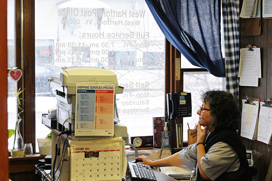 Postmaster Rosi O'Connell in the former West Hartford Post Office in 2011 - COURTESY OF JAMES M. PATTERSON/VALLEY NEWS