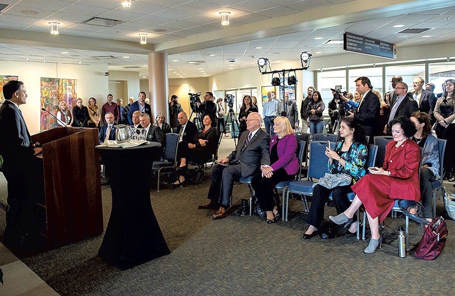 Sen. Patrick Leahy holding wife Marcelle's hand at the announcement of the scholarship - COURTESY OF SALLY MCCAY/UVM