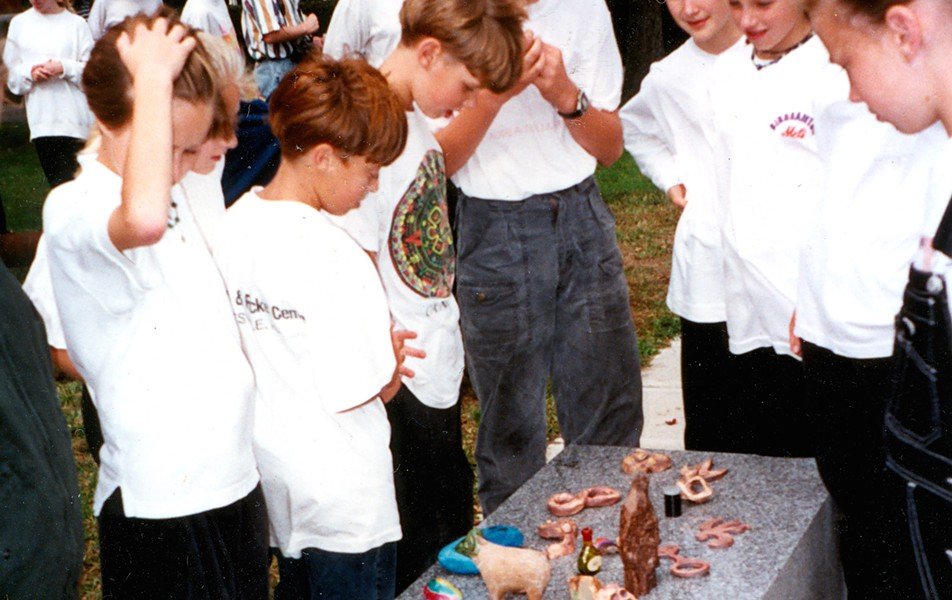 "Children look at their artworks to be buried under ""Zig Zag"" in 1994 - COURTESY OF KATE POND"