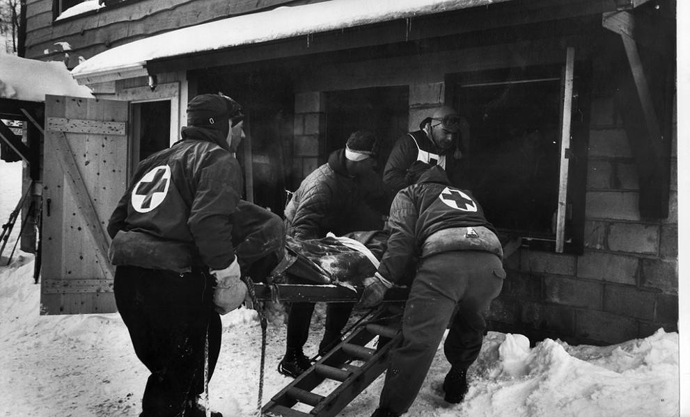 Ski patrol loads a victim into an aid room, 1959 - COURTESY OF ERIC FRIEDMAN