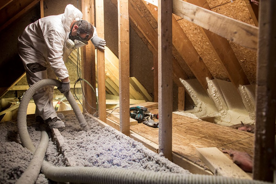 Installation of blow-in cellulose insulation - COURTESY OF EFFICIENCY VERMONT