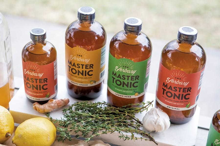 Fresh ingredients and finished Yerbary Master Tonic products - LUKE AWTRY