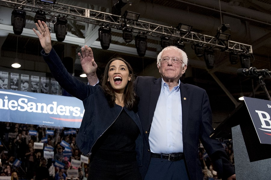 Sen. Bernie Sanders (I-Vt.) and Rep. Alexandria Ocasio-Cortez (D-N.Y.) taking the stage at the Whittemore Center Arena at the University of New Hampshire - ASSOCIATED PRESS