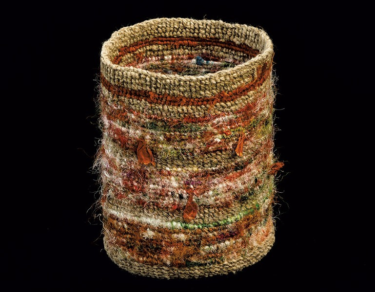 Colorful finger-weave twined bag made by Vera Sheehan of the Elnu Tribe. This is an ancient, traditional way of making bags from milkweed or other fiber material. - COURTESTY OF DIANE STEVENS