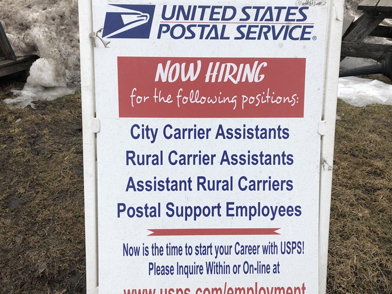 A help wanted sign at the Pine Street facility's parking lot - MOLLY WALSH