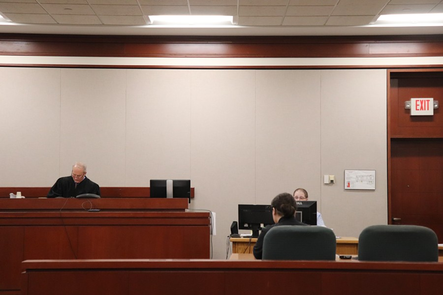 Judge Gregory Rainville presiding over a hearing in Chittenden County Superior Court on Monday - DEREK BROUWER