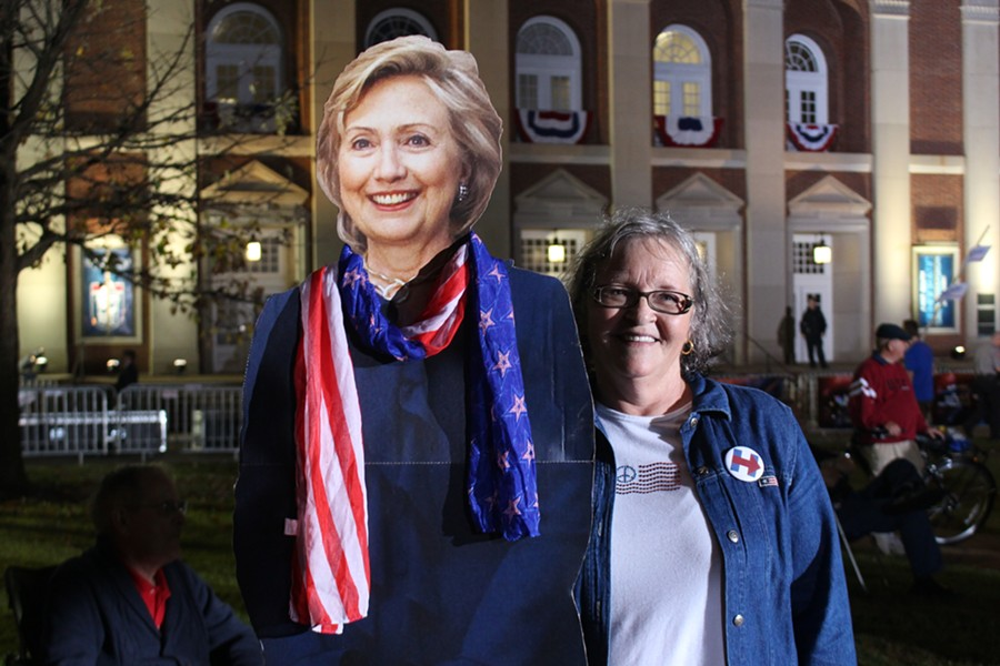 Ellen Friend holds a cardboard cutout of Hillary Clinton outside the Rock Hill forum - PAUL HEINTZ