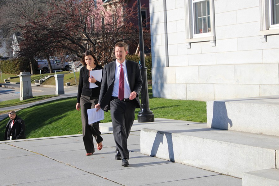 House Speaker Shap Smith and campaign manager Liz Sortino arrive at the Statehouse steps to announce the suspension of his campaign - PAUL HEINTZ