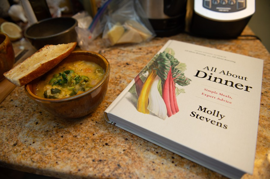 Bowl of soup and James Beard finalist cookbook by Molly Stevens - DARIA BISHOP