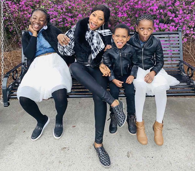 Francine Kasongo and her three children, from left: Alcina, Ariel and Andrea - COURTESY OF FRANCINE KASONGO