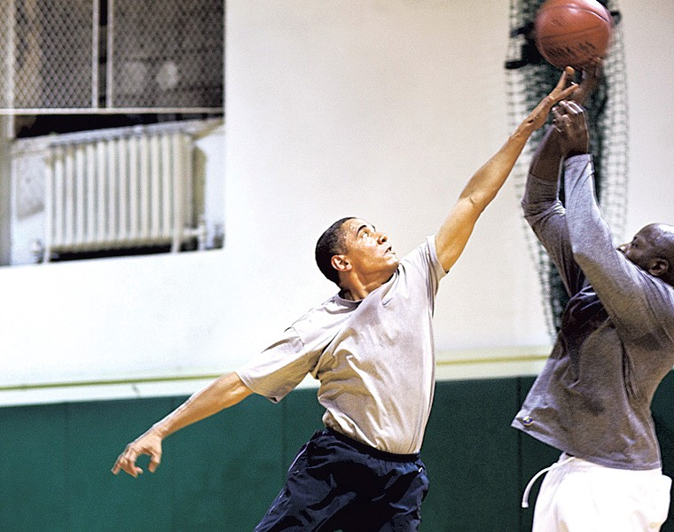 President Barack Obama playing basketball with personal aide Reggie Love - COURTESY OF PETE SOUZA