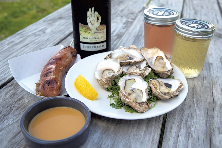 Grilled oysters and Kasekrainer sausage at Dedalus Wine Shop, Market & Wine Bar - JAMES BUCK