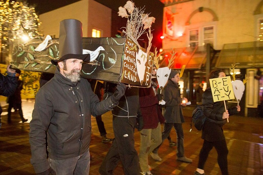 Glenn Eames carries a cardboard coffin to City Hall in protest of the Burlington College development agreement. - JAMES BUCK