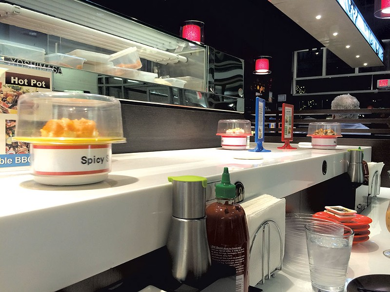 Conveyor belt sushi at A Cuisine - JOHN JAMES