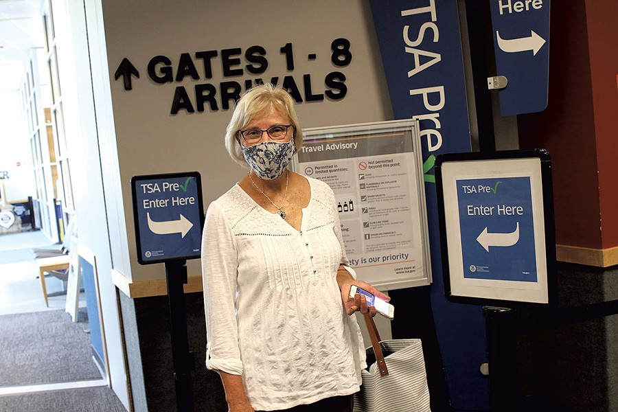 BTV airport commissioner Helen Riehle getting ready to board a flight to Detroit - COURTNEY LAMDIN ©️ SEVEN DAYS
