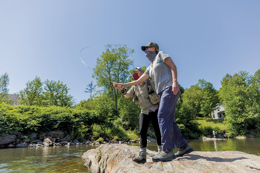 Guide Stephanie Olsen giving fly-fishing instruction in Stowe - OLIVER PARINI