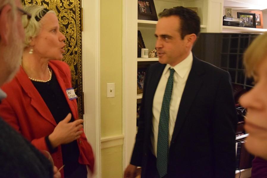 Matt Dunne, Democratic candidate for governor, talks Sunday with Jen Botzojorns. - TERRI HALLENBECK