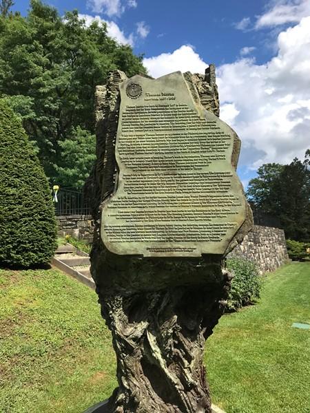Greg Wyatt's bronze sculpture of Thomas Moran, which includes a biography of Moran - SALLY POLLAK ©️ SEVEN DAYS