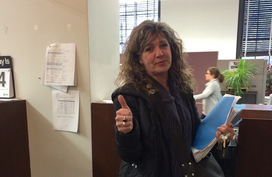 Karen Rowell, a New North End resident, drops off her petition at Burlington City Hall. - ALICIA FREESE