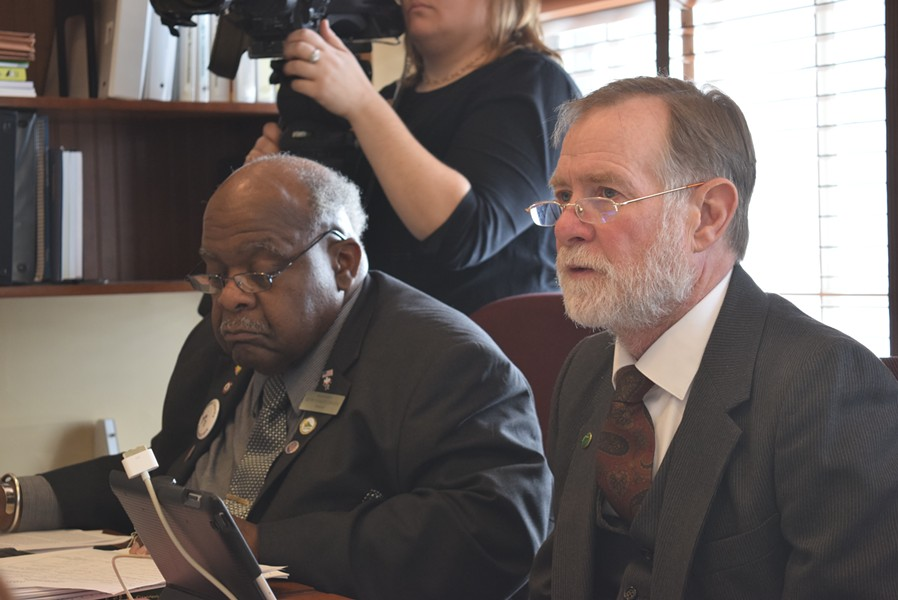 House Education Committee Chair David Sharpe (D-Bristol), right, and committee member, Rep. Kevin Christie (D-Hartford) listen Tuesday to debate about the education spending cap. - TERRI HALLENBECK