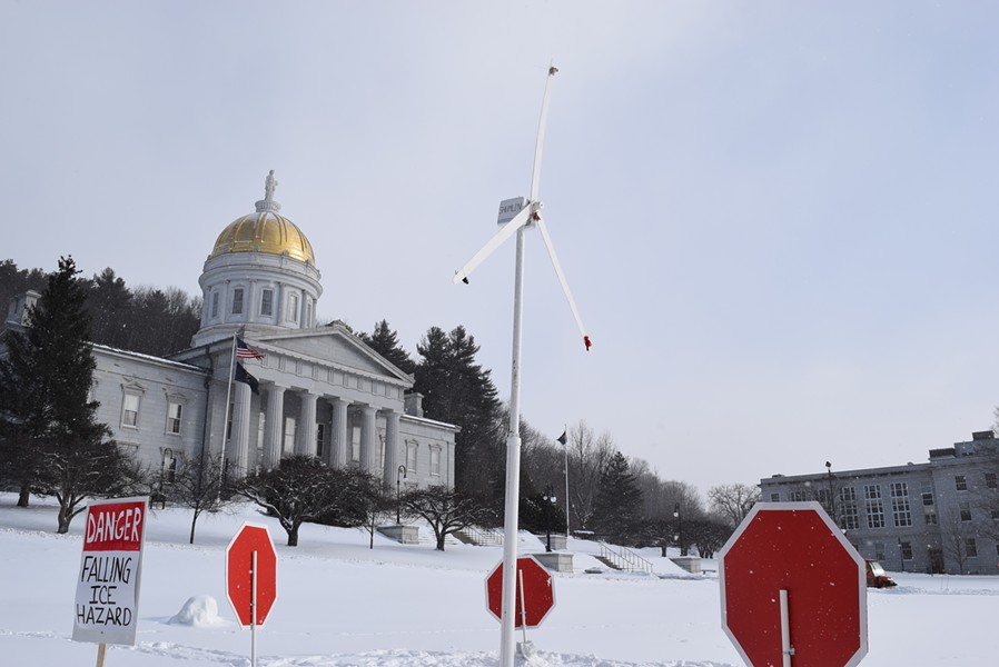 Vermont wind project opponents erected a model turbine on the Statehouse lawn. - TERRI HALLENBECK