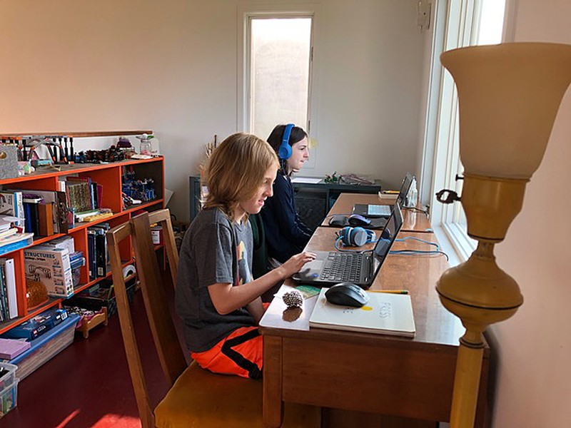 Dash and Lionelle doing remote schooling - COURTESY OF ANGELA ARSENAULT