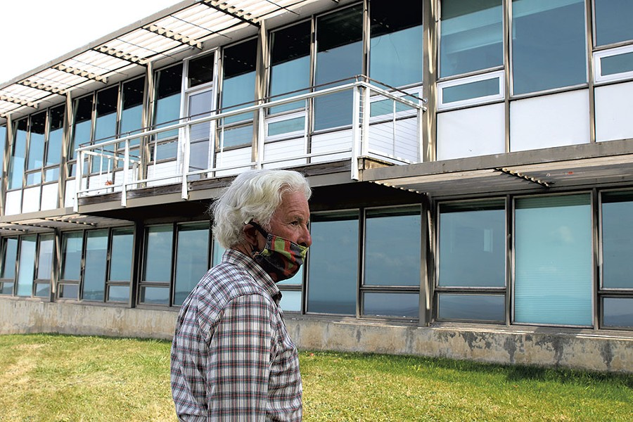 Project consultant John Caulo outside of Building 32 - COURTNEY LAMDIN ©️ SEVEN DAYS