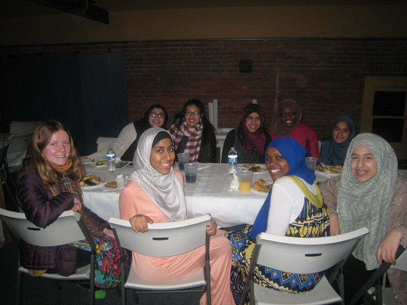 Students from South Burlington, Burlington, Essex and Colchester enjoying dinner at the Islamic Society of Vermont - KYMELYA SARI