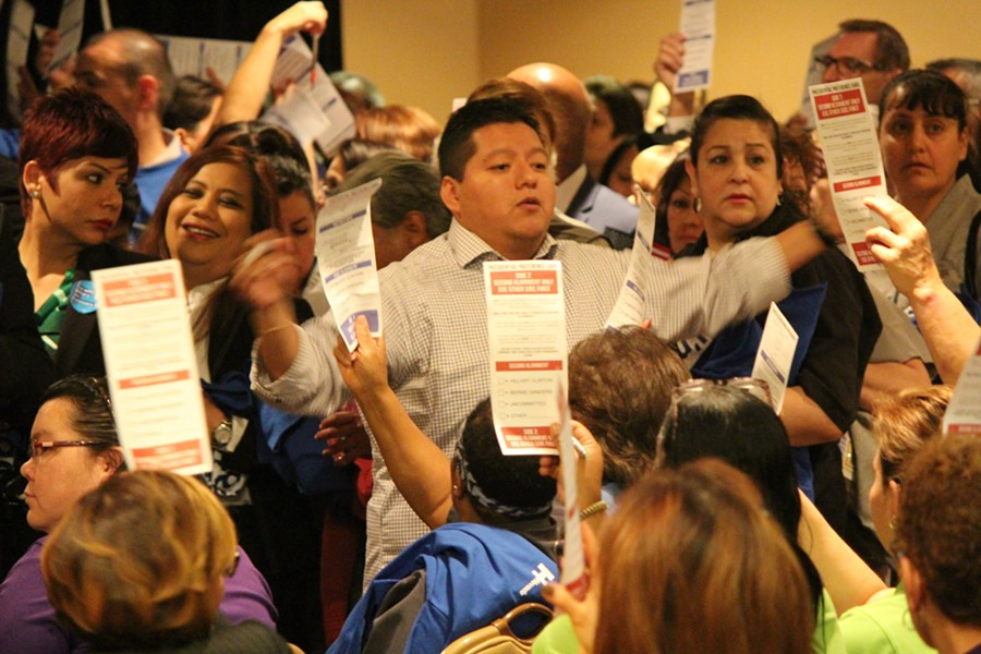Caucus vice chair Miguel Martinez counts participants Saturday at the New York-New York Hotel & Casino. - PAUL HEINTZ