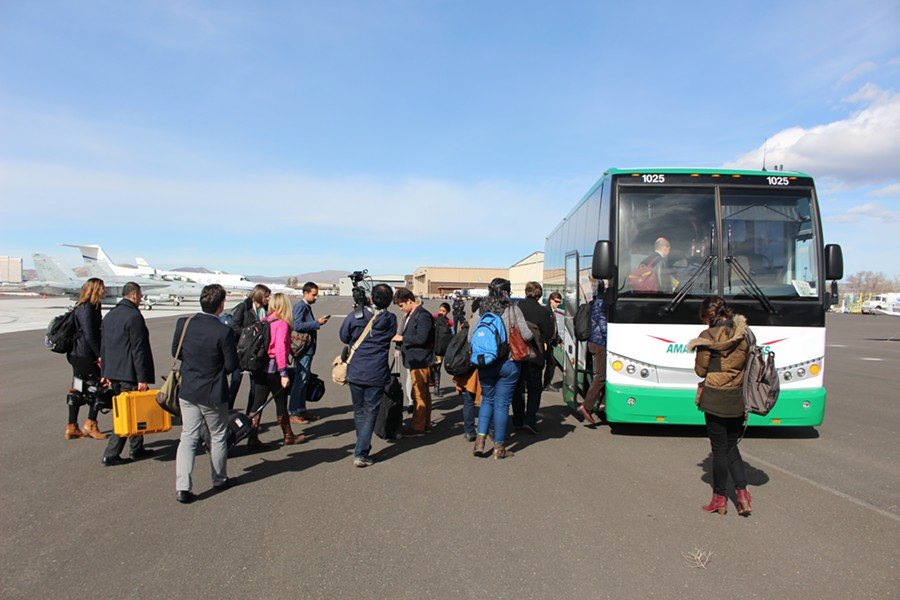 Sen. Sanders' traveling press corps board a bus at Reno-Tahoe International Airport - PAUL HEINTZ