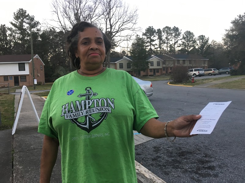 Wilhelmina Rivers holds an electricity bill after voting Saturday in Columbia, S.C. - PAUL HEINTZ
