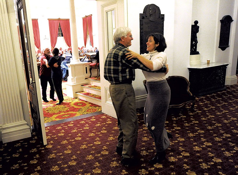 Rep. Mitzi Johnson and Rep. John Bartholomew waltzing during a concert in January - JEB WALLACE-BRODEUR
