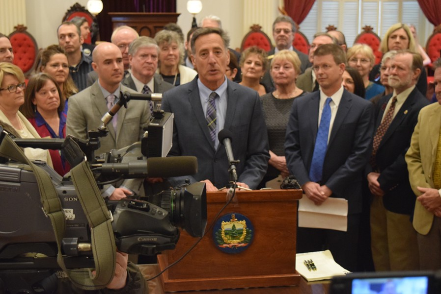 Gov. Peter Shumlin prepares to sign a bill requiring employers to provide paid sick leave. - TERRI HALLENBECK