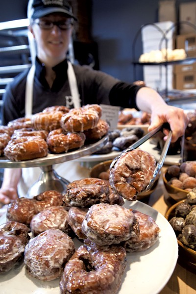 Lara Atkins with apple fritters at Parkside Kitchen - MATTHEW THORSEN